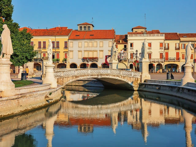 Canal in Padua Italy with bright houses